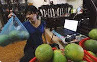Phuong, an employee of Hanoi Posts Company, also works as a part-time e-trader selling fruit in Hanoi. Vietnam's young, tech-savvy population is turning to the Internet to break out of an economic system stifled by decades of communist rule, leading to a boom in e-commerce