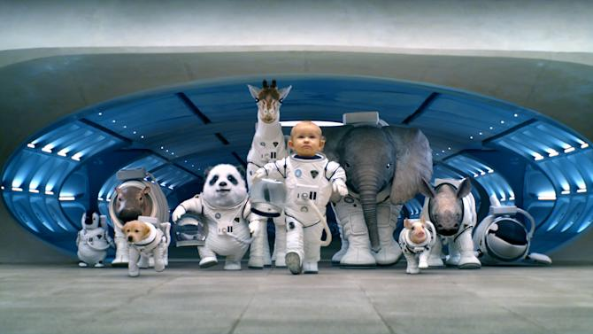 """This screen shot provided by Hyundai shows the Super Bowl advertisement by Hyundai Motor Group's Kia. In the advertisment, Kia invents a fanciful way that babies are made, blasting in from a baby planet in its """"Space babies"""" ad for the 2014 Sorento crossover. (AP Photo/Hyundai)"""