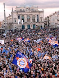 Montpellier's fans celebrate as they wait to watch the broadcast French L1 football match at the place de la Comedie in Montpellier, southern France