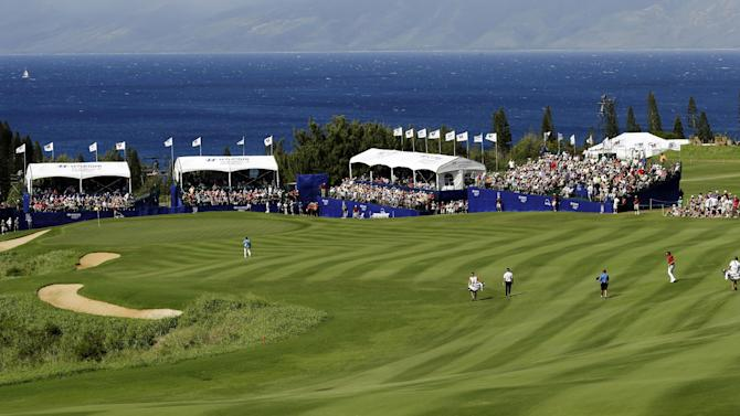 Players approach the 18th green and grandstands during the third and final round at the Tournament of Champions PGA Tour golf tournament, Tuesday, Jan. 8, 2013, in Kapalua, Hawaii. (AP Photo/Elaine Thompson)
