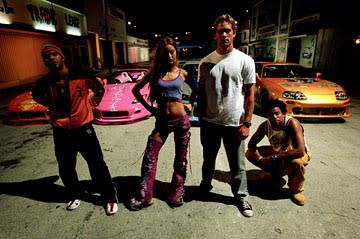 Amaury Nolasco as Orange Julius, Devon Aoki as Suki, Paul Walker as Brian O'Conner and Michael Ealy as Slapjack in Universal's 2 Fast 2 Furious
