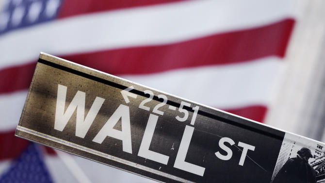 FILE - This Aug. 9, 2011 file photo shows a Wall Street street sign near the New York Stock Exchange, in New York. The British pound jumped and world stock benchmarks rose Friday Sept. 19, 2014 as Scotland voted to stay part of the United Kingdom, avoiding a messy breakup that could have roiled financial markets.   (AP Photo/Mark Lennihan, File)