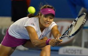 Li Na of China hits a return against Dominika Cibulkova …