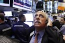 FILE - In this Thursday, Dec. 6, 2012 file photo, trader Peter Tuchman works on the floor of the New York Stock Exchange, in New York. Stocks are opening mixed on Wall Street, Monday, Dec. 10, 2012, after the surprise resignation of Italy's prime minister sent a jolt through European markets. (AP Photo/Richard Drew, File)
