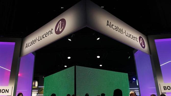 Visitors walk at the Alcatel-Lucent booth at the Mobile World Congress in Barcelona February 28, 2012. REUTERS/Albert Gea/Files