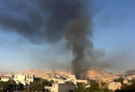 Smoke rises from the site of an explosion in Damascus. Two suicide bombs struck the heavily guarded Syrian army headquarters in the heart of Damascus on Wednesday, killing four guards and sparking a gunbattle between troops and rebels, state media said
