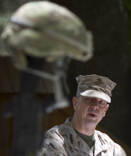 Gen. John Allen, the top U.S. commander in Afghanistan, observes Memorial Day by reading a letter written by an American soldier to his family before he died earlier this year, at the ISAF headquarters in Kabul, Afghanistan, Monday, May 28, 2012. (AP Photo/Anja Niedringhaus)