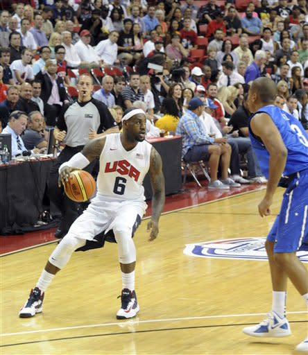 In this photo provided by the Las Vegas News Bureau, U.S. Olympic men's basketball team member LeBron James looks to pass against the Dominican Republic during an exhibition game in Las Vegas on Thursday, July 12, 2012. The United States won 113-59. (AP Photo/Las Vegas News Bureau, Brian Jones)