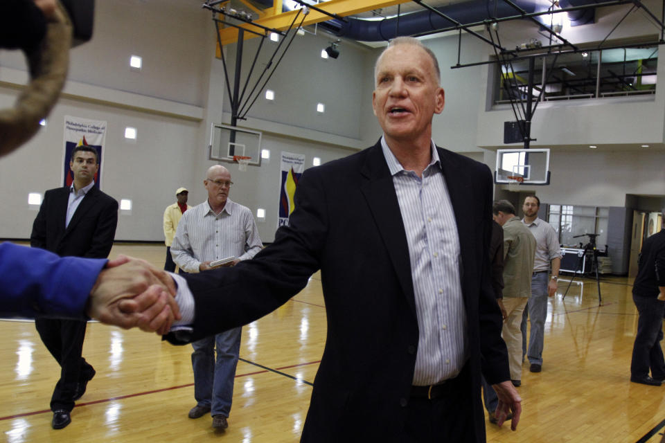 Doug Collins shakes hand with a television cameraman following a news conference where he announced his resignation as head coach of the Philadelphia 76ers NBA basketball team, Thursday, April 18, 2013 in Philadelphia. (AP Photo/Joseph Kaczmarek)
