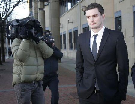 Sunderland soccer player Adam Johnson (R) leaves Bradford Crown Court in Bradford
