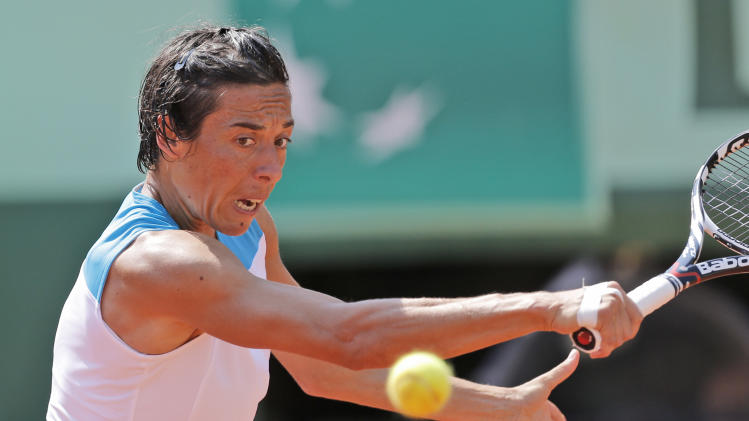Italy's Francesca Schiavone backhands to Japan's Kimiko Date-Krumm during their first round match in the French Open tennis tournament at the Roland Garros stadium in Paris, Tuesday, May 29, 2012. (AP Photo/Christophe Ena)