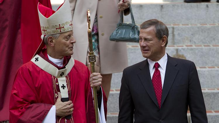 Cardinal Archbishop of Washington Donald Wuerl speak with U.S. Supreme Court Chief Justice John G. Roberts on the steps of the Cathedral of St. Matthew the Apostle after the 60th annual Red Mass in Washington on Sunday Sept. 30, 2012. The Red Mass is held traditionally in Washington the day before the Supreme Court's new term opens. (AP Photo/Jose Luis Magana)
