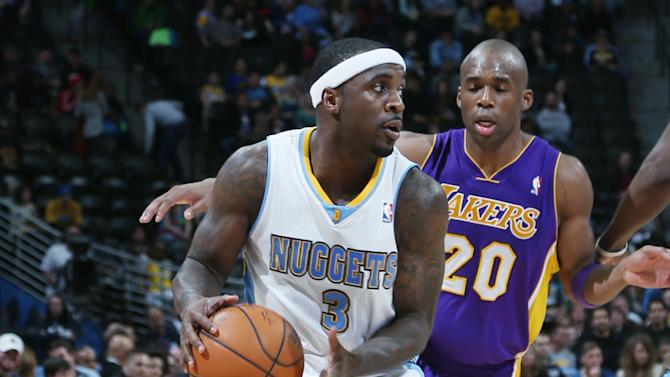 Denver Nuggets guard Ty Lawson, front, looks to pass ball as Los Angeles Lakers guard Jodie Meeks covers in the fourth quarter of the Nuggets' 134-126 victory in an NBA basketball game in Denver on Friday, March 7, 2014. (AP Photo/David Zalubowski)