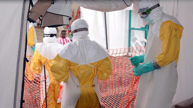 Health workers enter the Ebola treatment center run by Medecins Sans Frontieres in Monrovia, Liberia, on October 27, 2014