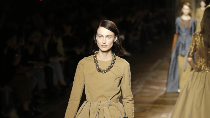 A model wears a creation for Dries Van Noten's fall-winter 2015-2016 fashion collection, as part of Paris Fashion week, presented in Paris, France, Wednesday, March 4, 2015. (AP Photo/Francois Mori)