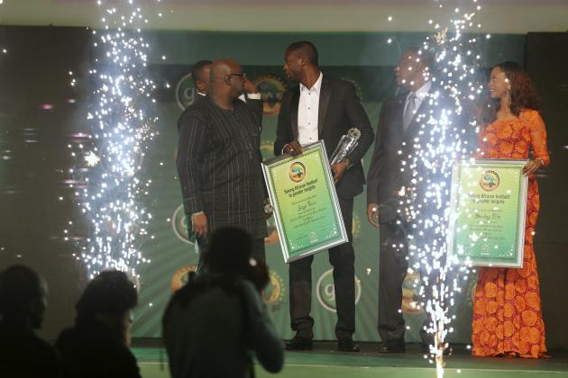 Toure holds his plaque after winning the African Footballer of the Year at the 2013 CAF Awards ceremony in Lagos