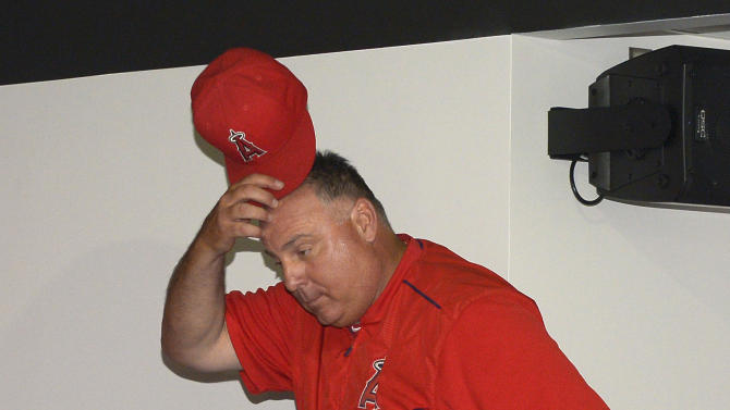 Los Angeles Angels manager Mike Scioscia walks in to a news conference following the Angels' baseball game against the New York Yankees, Wednesday, July 1, 2015, in Anaheim, Calif. Scioscia was on hand along with Angels president John Carpino to talk about the abrupt resignation of general manager Jerry Dipoto earlier Wednesday. (AP Photo/Mark J. Terrill)