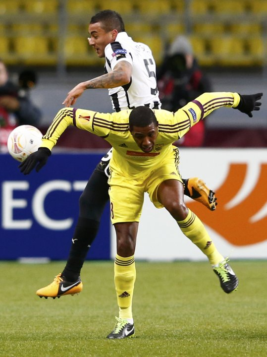 Anzhi Makhachkala's Jucilei fights for the ball with Newcastle United's Simpson during their Europa League soccer match at the Luzhniki stadium in Moscow