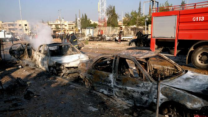 In this photo released by the Syrian official news agency SANA, damages cars are seen after an explosion hit a university in Aleppo, Syria, Tuesday, Jan. 15, 2013. Two explosions struck the main university in the northern Syrian city of Aleppo on Tuesday, causing an unknown number of casualties, state media and anti-government activists said. There were conflicting reports as to what caused the blast at Aleppo University, which was in session Tuesday. (AP Photo/SANA)