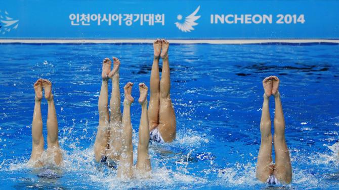 North Korea's synchronised swimming team take part in a practice session at Munhak Park Tae-hwan Aquatics Center ahead of the 17th Asian Games in Incheon