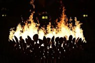 The Olympic flame burns during the opening ceremony of the London 2012 Olympic Games at the Olympic Stadium in London