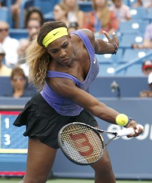 Serena Williams returns a volley to Caroline Wozniacki, from Denmark, during a semifinal match at the Western & Southern Open tennis tournament, Saturday, Aug. 16, 2014, in Mason, Ohio. (AP Photo/David Kohl)