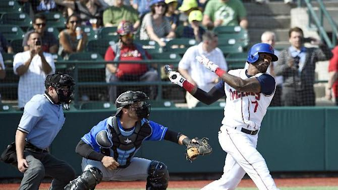 Brooklyn Cyclones' Jose Reyes (7) strikes out for his first at-bat as Daniel De La Calle, center, catches for the Hudson Valley Renegades in the first inning of a minor league baseball game, Sunday, June 26, 2016, in New York. (AP Photo/Kathy Kmonicek)