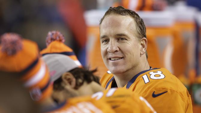 Denver Broncos quarterback Peyton Manning (18) talks with teammates on the sidelines in the fourth quarter of an NFL football game against the New Orleans Saints, Sunday, Oct. 28, 2012, in Denver. The Broncos won 34-14. (AP Photo/Jack Dempsey)
