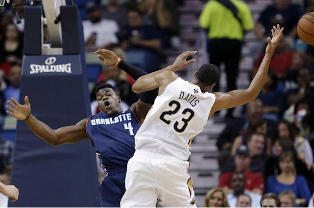 New Orleans Pelicans forward Anthony Davis (23) is fouled by Charlotte Bobcats forward Jeff Adrien (4) in the first half of an NBA basketball game in New Orleans, Saturday, Nov. 2, 2013
