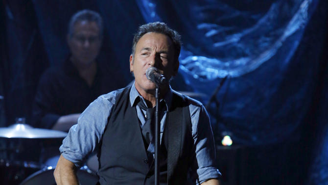 """In this photo provided by NBC, Bruce Springsteen performs during """"Hurricane Sandy: Coming Together"""" Friday, Nov. 2, 2012, in New York. Hosted by Matt Lauer, the event is heavy on stars identified with New Jersey and the New York metropolitan area, which took the brunt of this week's deadly storm. (AP Photo/NBC, Heidi Gutman)"""