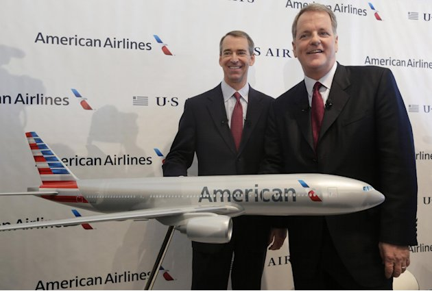 U.S. Airways CEO Doug Parker, right, and American Airlines CEO Tom Horton pose after a news conference at DFW International Airport Thursday, Feb. 14, 2013, in Grapevine, Texas. The two airlines will merge forming the world&#39;s largest airlines. (AP Photo/LM Otero)