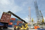 A crane tries to load a container on a truck at Takoradi. Ghana's recently deceased president John Atta Mills oversaw the start of large-scale oil production in 2010. Ghana was plunged into mourning after the sudden death of president John Atta Mills five months ahead of elections in the country seen as a bastion of democracy in west Africa