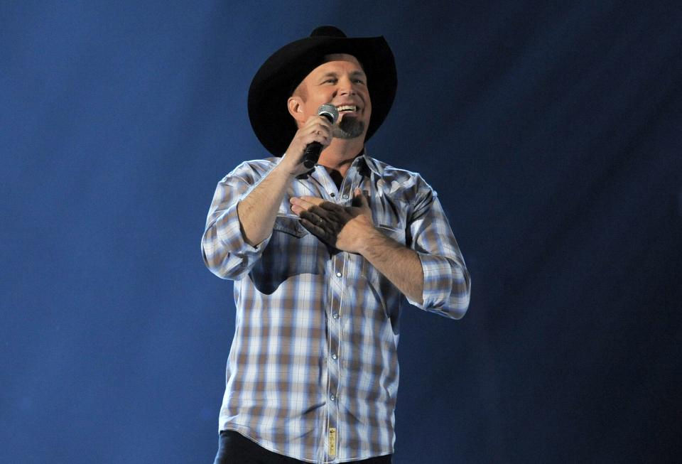 FILE - This April 7, 2013 file photo shows Garth Brooks performing at the 48th Annual Academy of Country Music Awards in Las Vegas, Nev. Brooks will perform a rare live broadcast concert special from the Encore Theater at the Wynn Las Vegas on Friday, Nov. 29. (Photo by Chris Pizzello/Invision/AP, File)