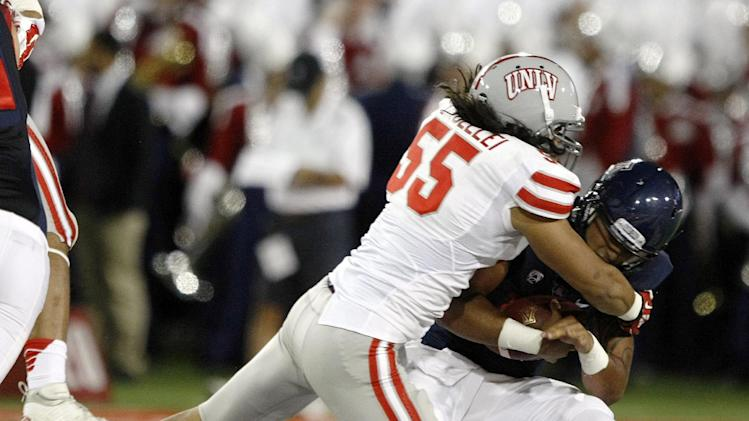 UNLV linebacker Tau Lotulelei (55) sacks Arizona quarterback Anu Solomon (12) during the first half of an NCAA college football game, Friday, Aug. 29, 2014, in Tucson, Ariz. (AP Photo/Rick Scuteri)