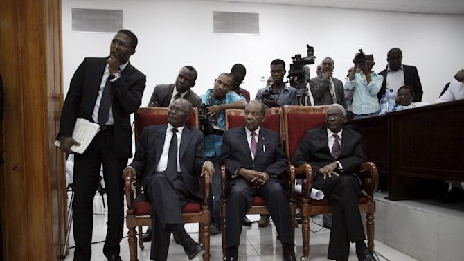 Provisional president candidates wait for the counting of the votes at the Special Bicameral Commission for the election of the provisional President of the Republic in the Haitian Parliament in Port-au-Prince