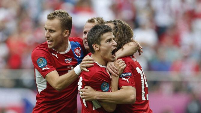 Wroclaw : Czech players celebrate after they scored the first goal during the Euro 2012 soccer championship Group A match between Greece and Czech Republic in Wroclaw, Poland, Tuesday, June 12, 2012.  AP/PTI(AP6_12_2012_000213B)