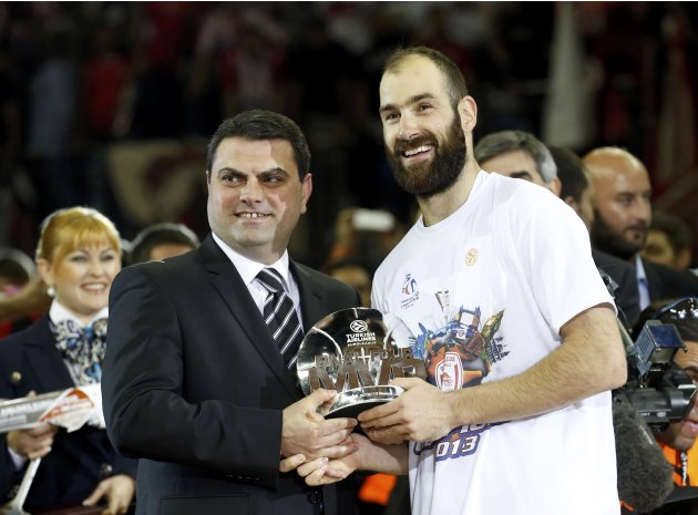 Olympiakos' Spanoulis receives the MVP trophy after their Euroleague Basketball Final Four final game against Real Madird at the O2 Arena in London