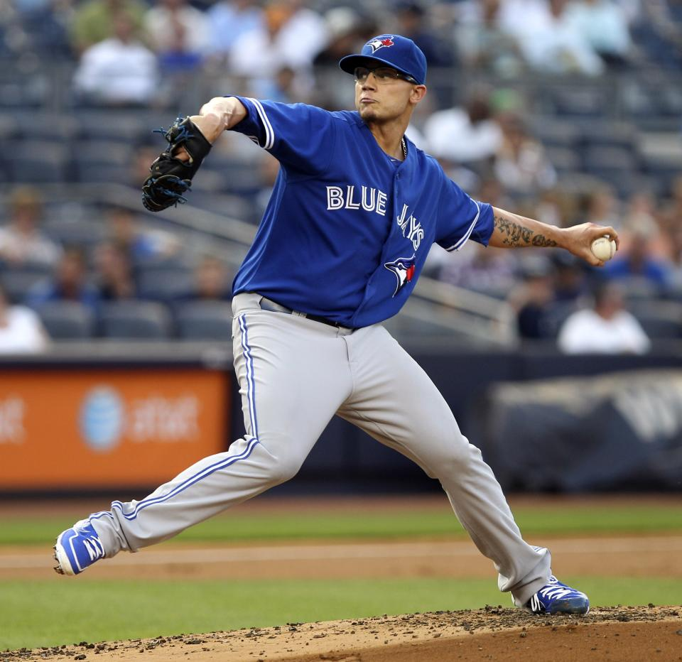 Toronto Blue Jays starting pitcher Brett Cecil delivers during the first inning of a baseball game against the New York Yankees, Tuesday, July 17, 2012, at Yankee Stadium in New York. (AP Photo/Seth Wenig)