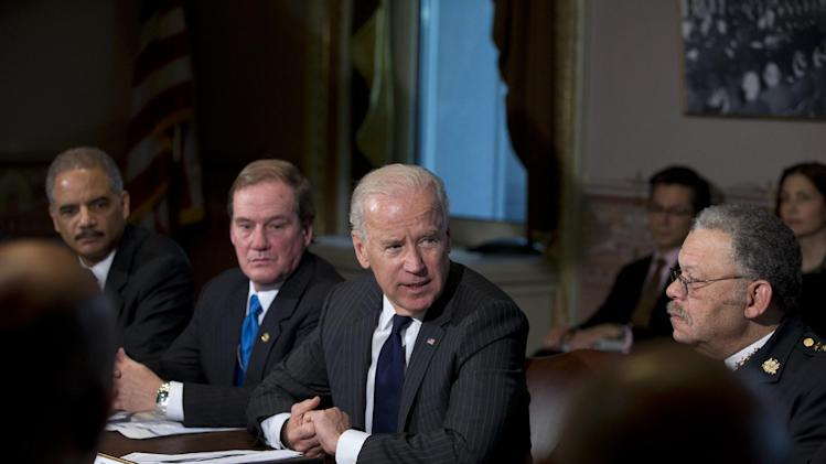 Vice President Joe Biden, second from right, with Attorney General Eric Holder, left, President of the National Association of Police Organizations and Boston police officer, Thomas Nee, second from left, and President of the Police Executive Research Forum and Major Cities Chiefs Association and Philadelphia Police Commissioner Charles Ramsey,  right, speaks to media during a meeting at the Eisenhower Executive Office Building in the White House complex, Thursday, Dec. 20, 2012, in Washington.  Biden is leading a task force that will look at ways of reducing gun violence.      (AP Photo/Carolyn Kaster)