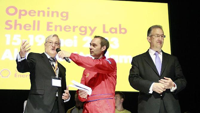 IMAGE DISTRIBUTED FOR SHELL - Royal Dutch Shell CEO Peter Voser, left, and the Mayor of Rotterdam, Ahmed Aboutaleb, right, seen during the Shell Energy Lab opening ceremony at the Shell Eco-marathon Challenge Europe at The Ahoy centre in Rotterdam, The Netherlands on Wednesday, May 15, 2013. Teams from universities all over Europe have brought their energy efficient cars to compete through the three-day challenge. (Jiri Buller/AP Images for Shell)