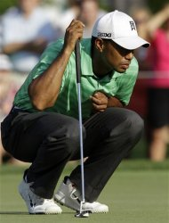 Tiger Woods lines up a putt during the second round of the Greenbrier Classic PGA Golf tournament at the Greenbrier in White Sulphur Springs, W. Va., Friday, July 6, 2012. Woods missed the cut. (AP Photo/Steve Helber)