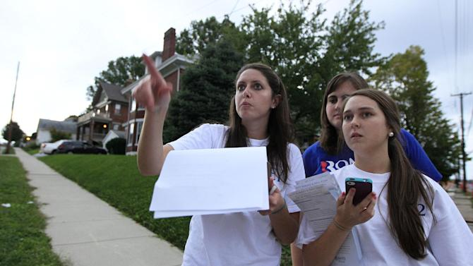 Republican presidential candidate former Massachusetts Gov. Mitt Romney supporters, left to right, Beth Hamad, Kristin Turner, and Leslie Reynolds, plan their route, Tuesday, Oct. 2, 2012, going door to door to get out the vote in Cincinnati. (AP Photo/Al Behrman)