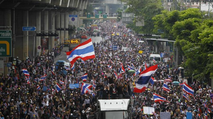 Anti-government protesters march toward Thailand's Finance Ministry in Bangkok