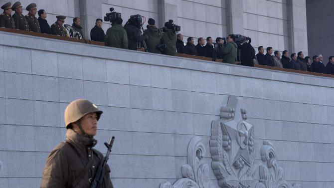 North Korean leader Kim Jong Un, top seventh from left, attends a ceremony to reopen the Kumsusan Palace of the Sun in Pyongyang, North Korea, Monday, Dec. 17, 2012. North Korean officials reopened the mausoleum on the first anniversary of the death of his father, leader Kim Jong Il. (AP Photo/Ng Han Guan)