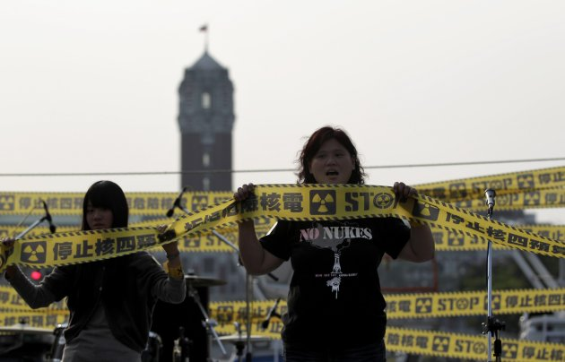 Anti-nuclear activists shout slogans during a protest in front of the Presidential Office in Taipei