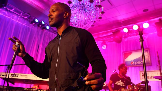 IMAGE DISTRIBUTED FOR PEPSI - Jamie Foxx  and Captain Kirk Douglas of The Roots perform at the Pepsi 5th Quarter in the French Quarter Post Super Bowl Party, on Sunday, Feb. 3, 2013, in New Orleans. (Photo by Barry Brecheisen/Invision for Pepsi/AP Images)