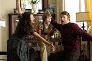 This film image released by Disney shows, from left, Jennifer Garner, CJ Adams, and Joel Edgerton in a scene from &quot;The Odd Life Of Timothy Green.&quot; (AP Photo/Disney, Phil Bray)