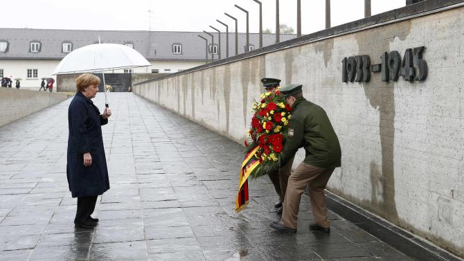 German Chancellor Merkel lays a wreath during a ceremony at the memorial in the former German Nazi concentration camp in Dachau