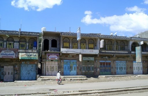 Yemeni men walk past closed shops in Daleh, 2010. A Yemeni soldier and an Al-Qaeda militant were killed Sunday as jihadists tried to raid a village in the southern province of Daleh