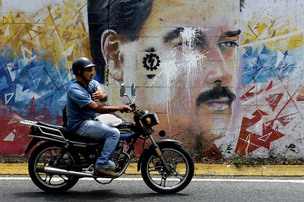 Maduro marks two years in power in tough times